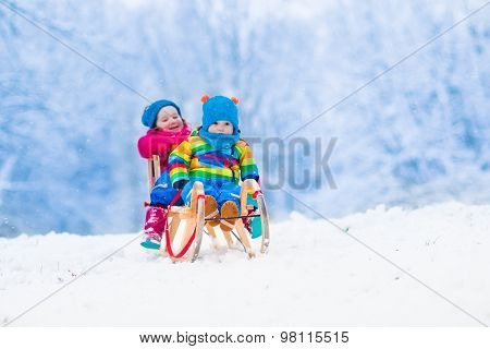 Kids Riding Sleigh In Winter Park