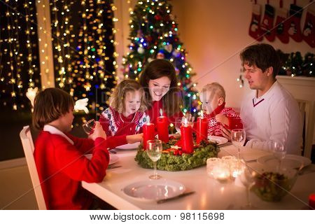 Family With Children At Christmas Dinner