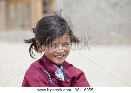 Portrait Of Tibetan Happy Girl In Druk White Lotus School. Ladakh, India