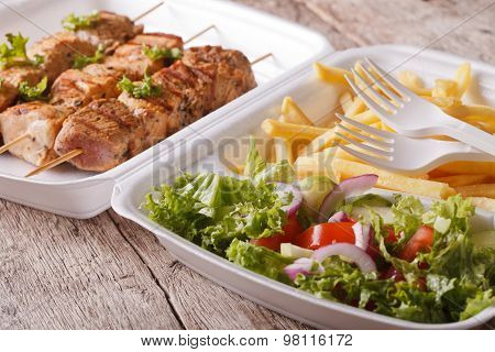 Fast Food: Kebabs, Fries And Fresh Salad In Tray Close-up. Horizontal