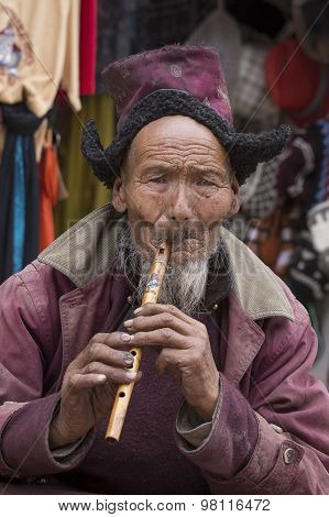 Portrait Tibetan Old Man On The Street In Leh, Ladakh. India