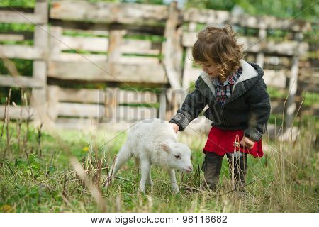 girl with lamb on the farm