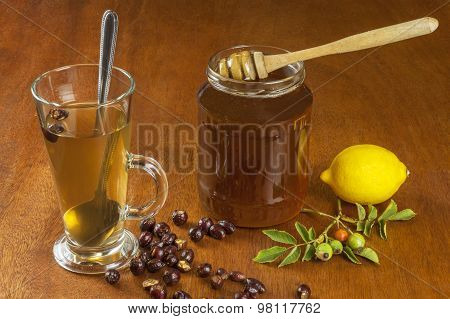 Hot tea with lemon and red arrow in the table. Home treatment for colds and flu.