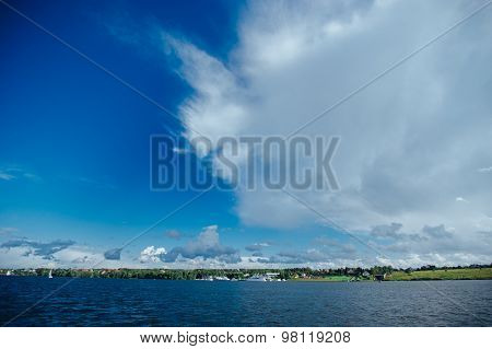 Expanse of water reservoirs, beautiful cloud drifting over the water