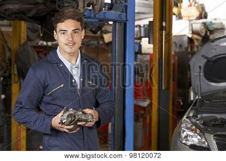 Portrait Of Apprentice Mechanic In Auto Repair Shop