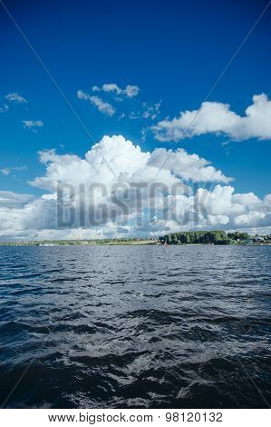 Beautiful view of the clouds and water from yacht floating on  lake.