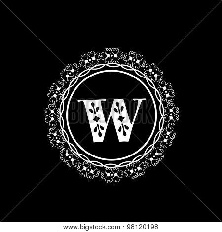 Premium monogram design with English Alphabet W in floral rounded frame on black background.