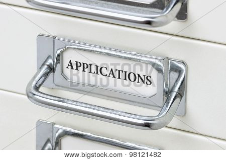 A Drawer Cabinet With The Label Applications