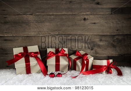 Classical wrapped gift boxes for christmas with red ribbon on wooden antique brown background for decoration.