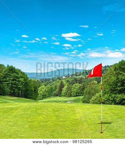 Green Golf Field And Cloudy Blue Sky