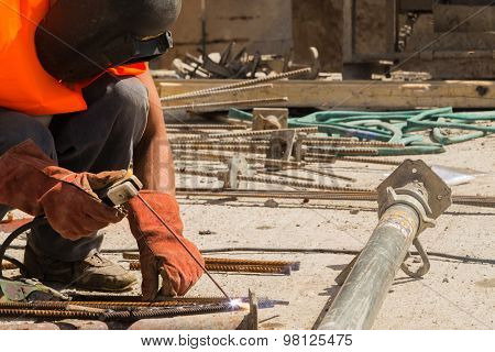 Welding. Welding metal rods into the net. Preparation for pouring concrete.