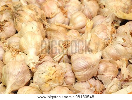 Close Up Of Pile Of Garlic On Market Stand