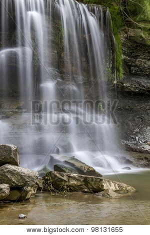 Waterfall Cascading Over Sedimentary Rock