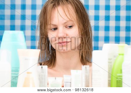 Girl Is Looking At Cosmetic Products