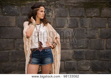 Hippy Young Woman Near Stone Wall Looking On Copy Space