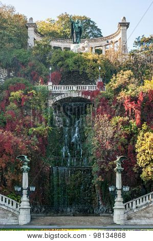 Waterfall entrance to the Citadel of Budapest, during the autumn station, when the leaves of the trees have red, yellow and green tones.