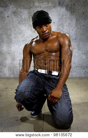 Muscular Black Man on a Concrete Background
