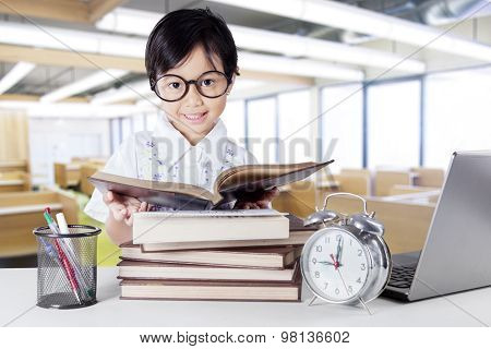 Attractive Little Learner Reading Book In Class
