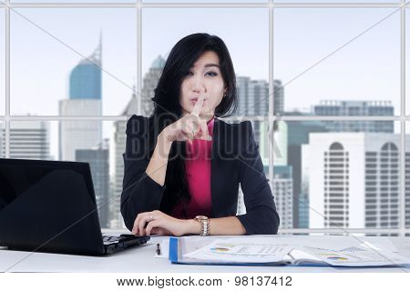 Female Worker Gesturing Silence