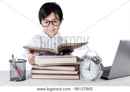 Kindergarten Learner Reading Book On The Table