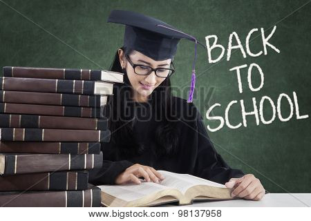 Learner With Mortarboard Reading Book