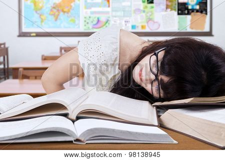 Student Studying In The Class And Sleep On The Book