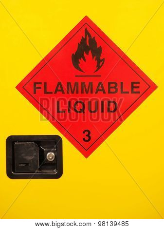 Flammable liquid cabinet door with warning sign and lock