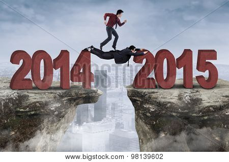 Two Businessmen Work Together Above A Gap