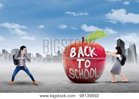 Two Learners And Apple With Text Of Back To School