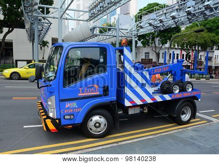Repairing Roads On The One Of Singapore Street