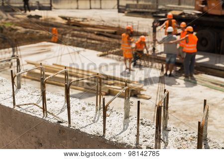 Pouring the concrete foundation of the building site shopping center down the