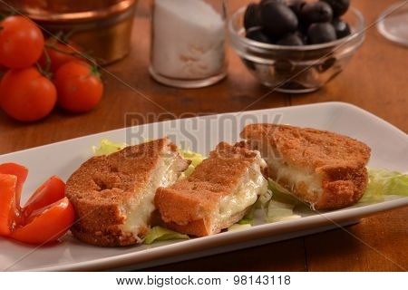 Breaded mozzarella cheese snack dish.