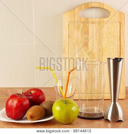 Fresh fruit glasses and blender to prepare vitamin fresh