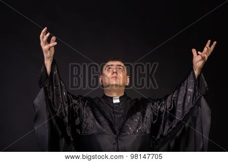 The actor plays the role of a priest.