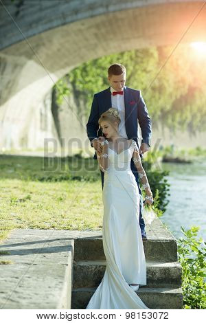 Beautiful Wedding Couple Under Bridge