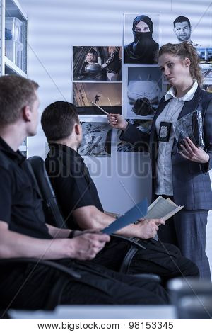 Policewoman Presenting Materials