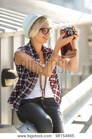 Beautiful Smiling Girl In Hat Making Photo Of Vintage Film Camera