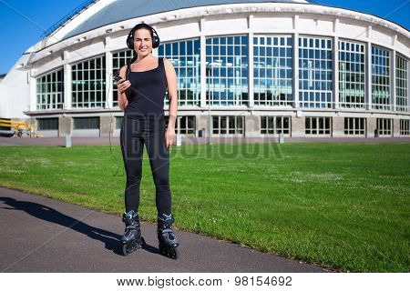 Portrait Of Cute Young Girl In Roller Skates Listening Music