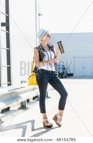 Hipster Girl Drinking Coffee From Thermos At Parking Lot