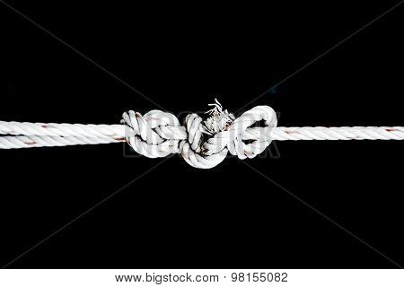 Knot Of White Rope On Black Isolate