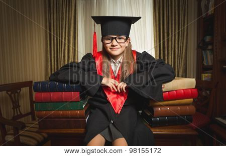 Genius Girl In Graduation Clothes Leaning On Book At Library