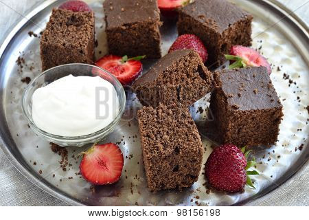 Chocolate sponge cake with strawberries and cream