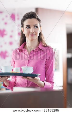 Young Cheerful Waitress At The Cafe