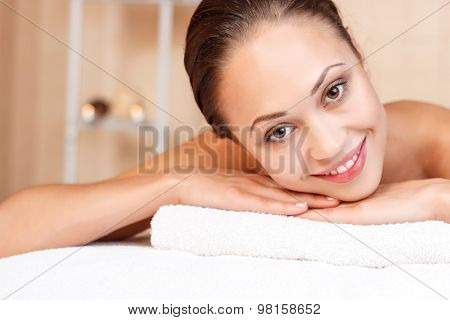 Smiling woman lying on couch