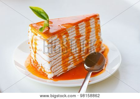 Thai tea crape cake on white background