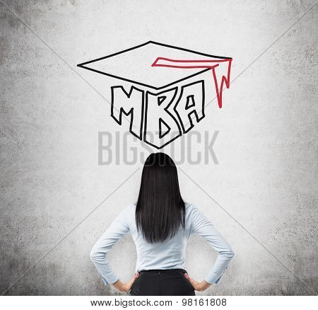 Rear View Of The Young Brunette Lady Who Is Thinking About Mba Degree. Drawn A Graduation Hat On The