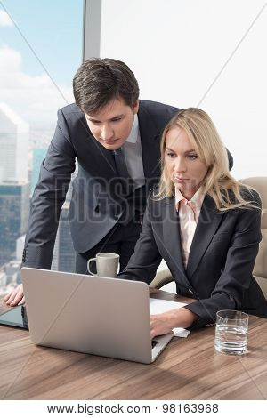 Business Couple Is Discovering Some Essential Business Information In The Laptop In The Panoramic Of