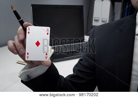 Businessman In Office Holding Ace Card And A Pen