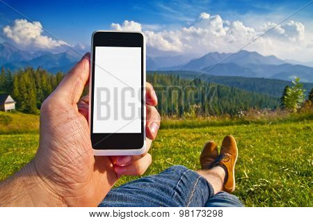 Empty Smartphone Screen In Man's Hand Against Landscape
