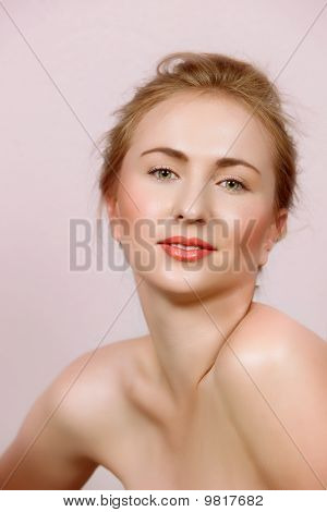 Blond Woman With Natural Make-up On Pink.